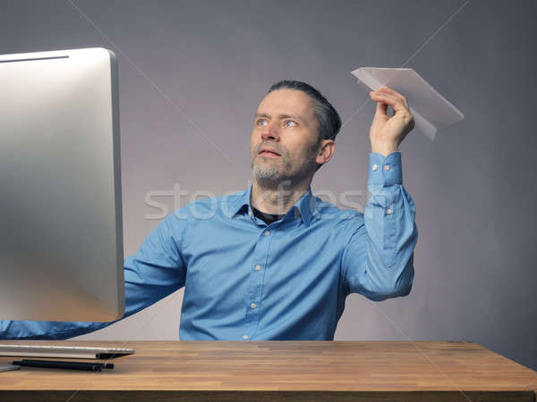 Businessman with a paper plane Stock photo © andreasberheide
