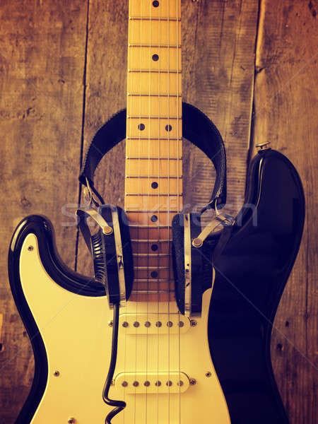 Vintage guitar with old studio headphones on wood Stock photo © andreasberheide