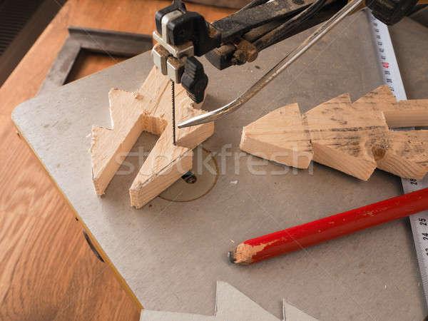 Wood working with a scroll saw Stock photo © andreasberheide