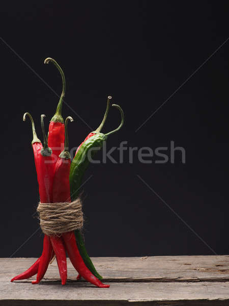 Delicious chilies on a wooden table Stock photo © andreasberheide