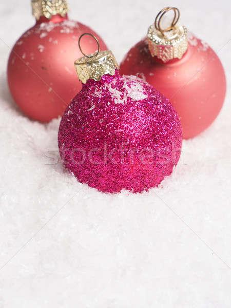 Pink Christmas baubles on snow Stock photo © andreasberheide