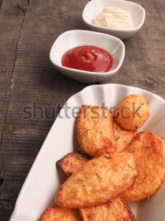 Biberiye patates ketçap mayonez rustik ahşap masa Stok fotoğraf © andreasberheide