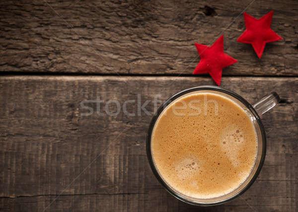 Delicioso taza café rústico mesa de madera luz Foto stock © andreasberheide