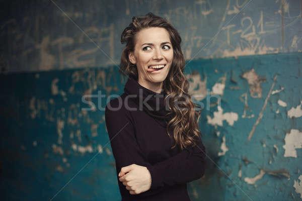 Nina hermosa moderna modelo lengua Foto stock © andreonegin
