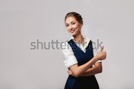 Beautiful elegant young bussines woman standing on the studio with gray background Stock photo © andreonegin