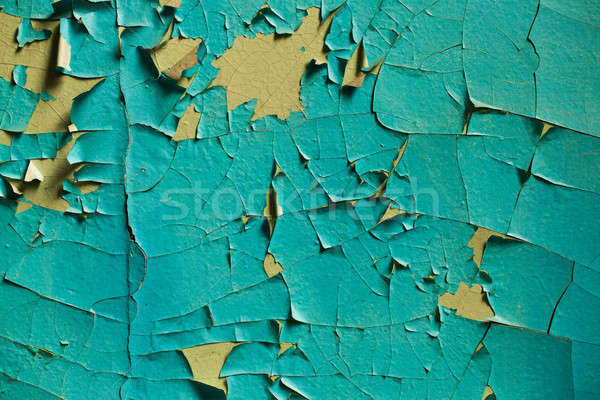 Cracked wall with old layers of paint in abandoned house Stock photo © andreonegin