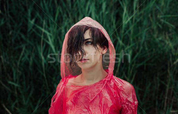 Portré lány piros esőkabát eső szomorú Stock fotó © andreonegin