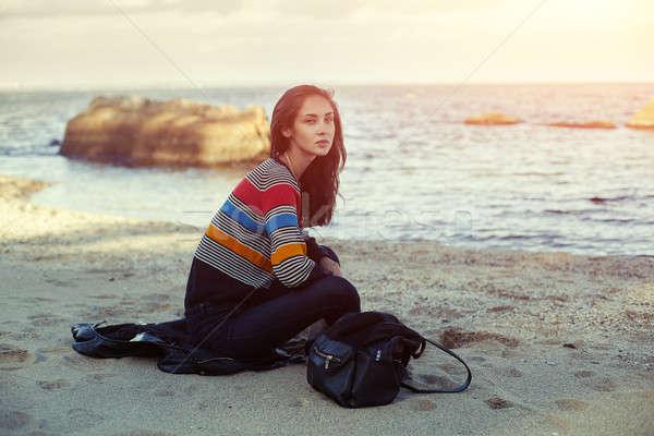 девушки пляж морем осень сидят песок Сток-фото © andreonegin