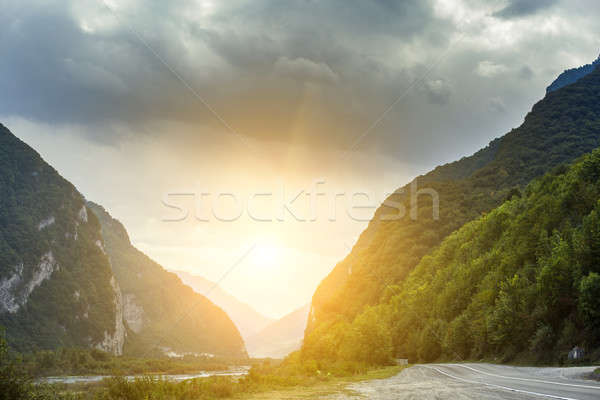 Carretera paisaje montanas asfalto nublado cielo Foto stock © andreonegin