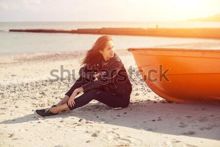 красивая женщина джинсов куртка морем сидят весны Сток-фото © andreonegin