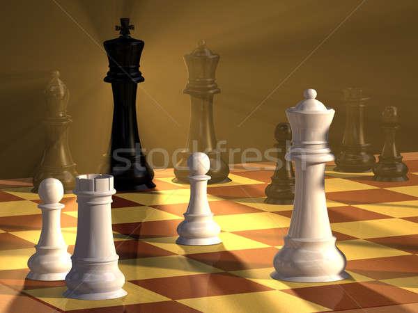 Ajedrez duelo piezas de ajedrez bordo dramático iluminación Foto stock © Andreus