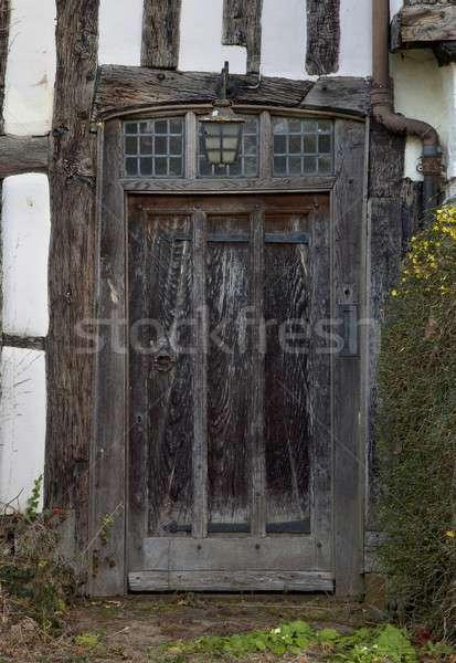 Kapualj elöl bejárat öreg kunyhó otthon Stock fotó © andrewroland