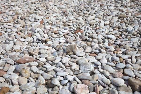 Kavics tengerpart kavicsok öböl absztrakt háttér Stock fotó © andrewroland