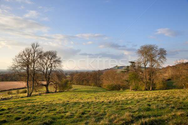 Rural regarder colline printemps coucher du soleil paysage Photo stock © andrewroland
