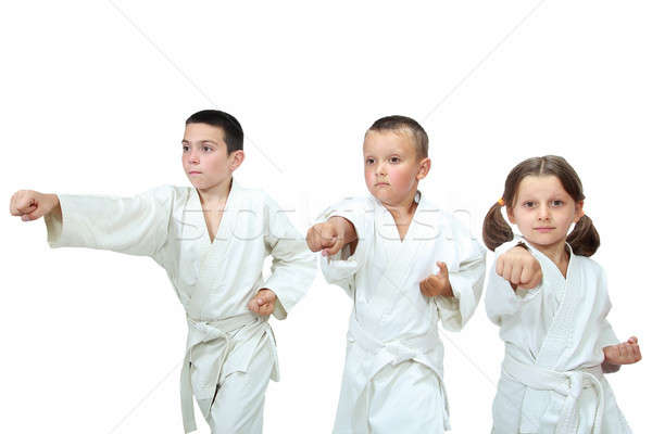 The girl and two boys in kimono beat punch arm Stock photo © Andreyfire