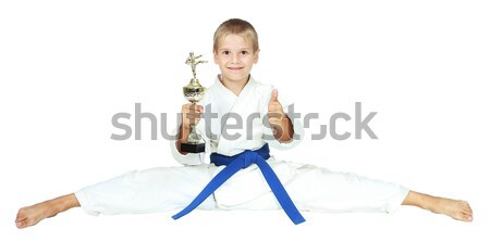 Boy in a kimono sits on a twine with the award at the hands of isolated Stock photo © Andreyfire