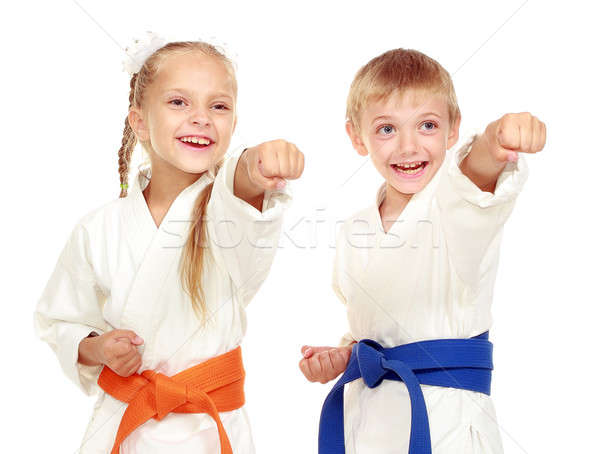 Girl and boy in a kimono on a white background beat hand Stock photo © Andreyfire