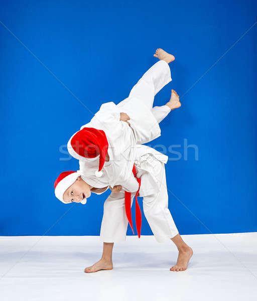 Throws Judo the athletes are train in caps of Santa Claus Stock photo © Andreyfire