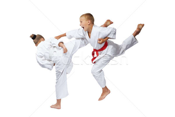 On a white background sportsmens are beating blows karate Stock photo © Andreyfire
