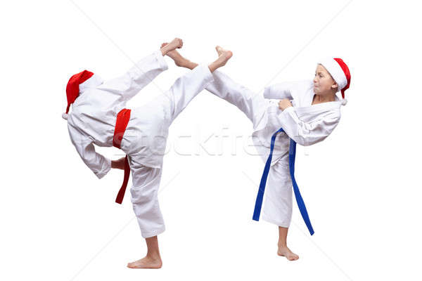 High blows leg children beats in caps of Santa Claus Stock photo © Andreyfire