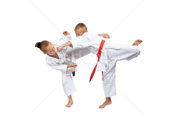 Young athletes beat karate blows Stock photo © Andreyfire
