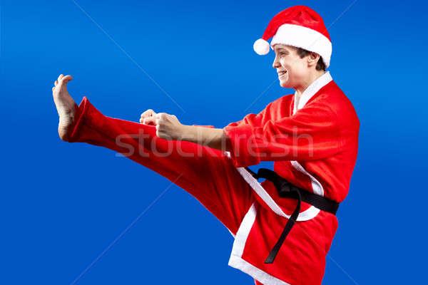 Kick forward beats sportswoman with a black belt Stock photo © Andreyfire