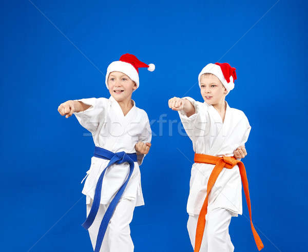 In caps of Santa Claus sportsmens are beating blows hands Stock photo © Andreyfire