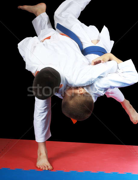 Beautiful high throw are doing  sportsmen in judogi Stock photo © Andreyfire