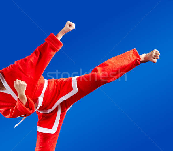 Sportswoman dressed as Santa Claus hits a high kick Stock photo © Andreyfire