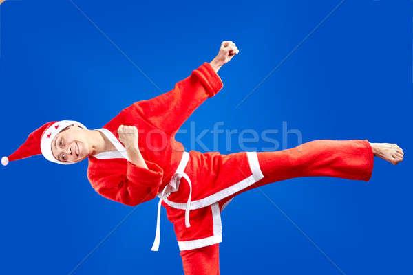 Sportswoman is training blow leg Stock photo © Andreyfire