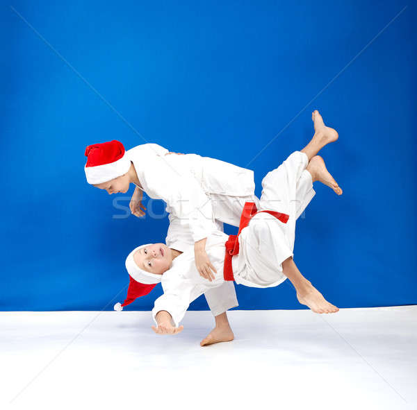 Children in judogi are training throws Stock photo © Andreyfire