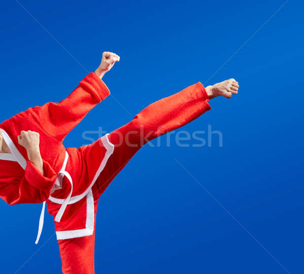 Karate blows and kicks in red Santa Claus clothes Stock photo © Andreyfire