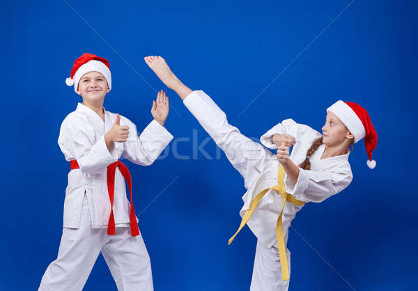 Children trains karate blows and shows finger Super Stock photo © Andreyfire