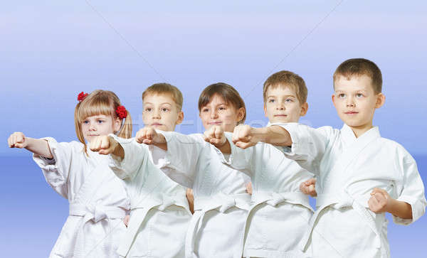 On a light background the little athletes beats punch arm Stock photo © Andreyfire