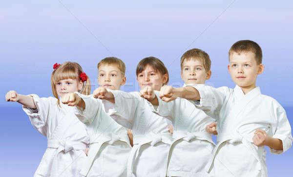 Fény kicsi sportolók kar lány gyerekek Stock fotó © Andreyfire