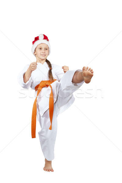 Blow leg sportswoman beats in cap Santa Claus Stock photo © Andreyfire