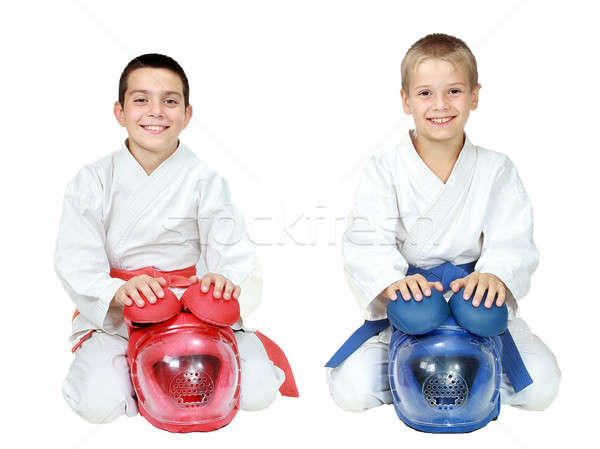 Athletes in kimono sitting in a ritual pose karate with helmets isolated Stock photo © Andreyfire
