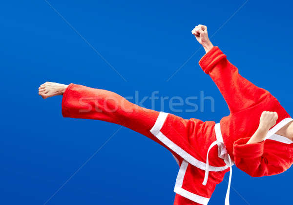 In cloth Santa Claus girl is beating blow leg Stock photo © Andreyfire