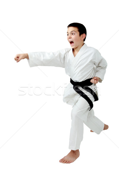 The little boy with a black belt beat a punch hand Stock photo © Andreyfire