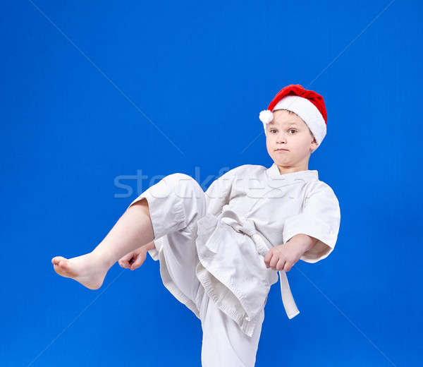 Boy with a white belt beats kicking Stock photo © Andreyfire