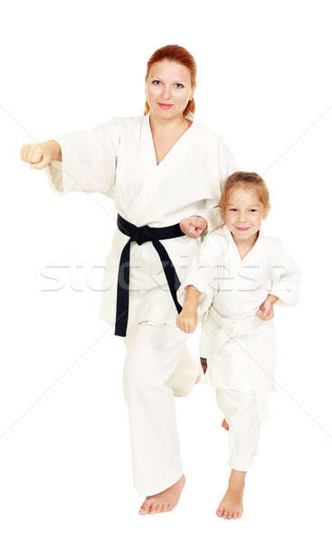 Mom and daughter with a smile in a kimono hit a hand on a white background Stock photo © Andreyfire