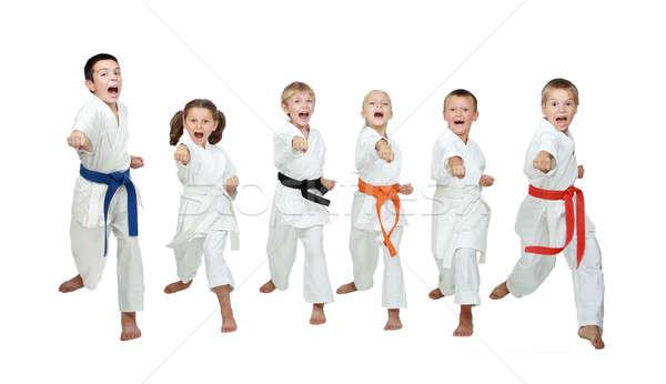 Hat fiatal sportolók kéz karate rúgás Stock fotó © Andreyfire