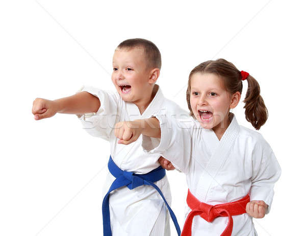 Small children in kimono beat a punch hand on a white background Stock photo © Andreyfire