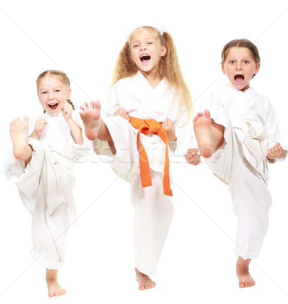 Three girls dressed in white kimono perform punch Stock photo © Andreyfire