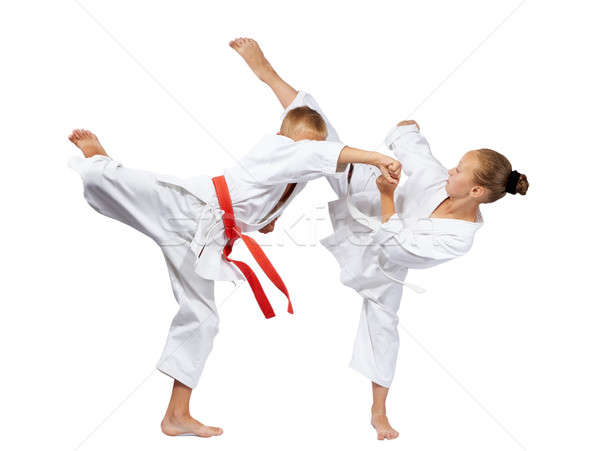 In karategi two athletes beats karate blows Stock photo © Andreyfire