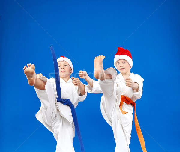High kick in perfoming  athletes in caps of Santa Claus Stock photo © Andreyfire