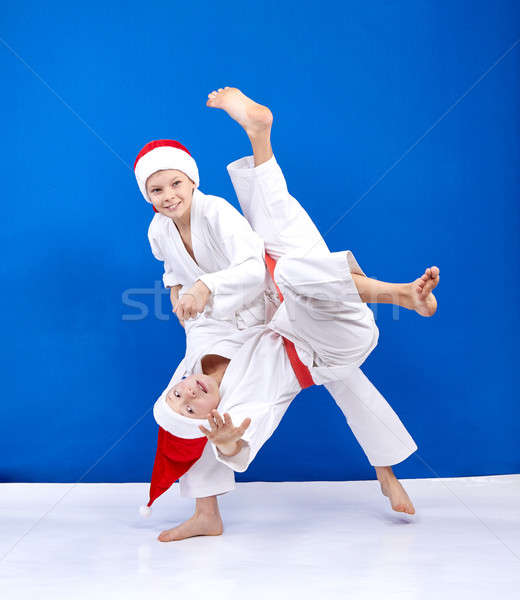 Two athletes in caps of Santa Claus trains throws Stock photo © Andreyfire