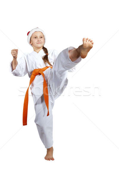 Girl in the cap of Santa Claus hits a kick foot forward Stock photo © Andreyfire