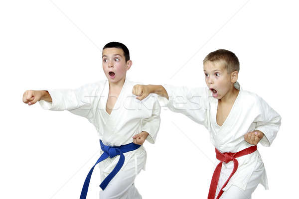 Two active athlete hit a punch arm Stock photo © Andreyfire