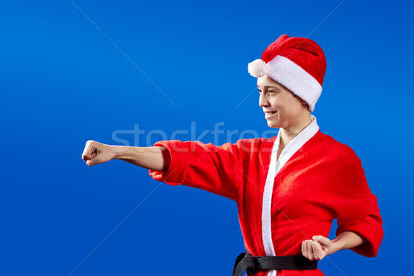 Girl with a black belt beats punch Stock photo © Andreyfire